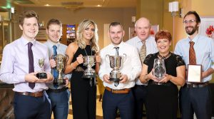 Niall Kerr, Brian Kerr, Seauna Mulholland, Ciaran Kerr, Ann Kerr, Peter Kerr and David Lavery, with some of the trophies for Kinnego Herefords, Lurgan, at the NI Hereford Breeders' Association dinner, Enniskillen. Picture: Cliff Donaldson