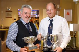 John Gill, chairman of the NI Hereford Breeders' Association, presenting Henry Richmond, Derrylin, with some of his trophies at the association's annual dinner, Enniskillen. Picture: Cliff Donaldson
