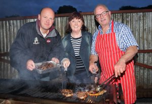 William Haire, Sharon McClean and Trevor Hooks busy cooking steaks on the barbecue. Picture: Cliff Donaldson