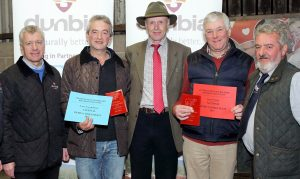 Eddie Boyd and Kenny Linton, from Dunbia, with David Wilson, reserve overall in the national herds competition, James Nelson, judge, John McMordie, champion overall in the national herds competition, and Hereford club chairman John Gill. Picture: Cliff Donaldson
