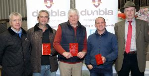 Kenny Linton, from Dunbia, with David Wilson, reserve in the large herd of the year competition, John McMordie, champion large herd of the year, John Conlon, third place in the large herd of the year competition, and James Nelson, judge. Picture: Cliff Donaldson