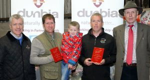 Kenny Linton, from Dunbia, with Glen Morton, reserve in the medium herd of the year competition, Trevor Andrews, champion medium herd of the year, and James Nelson, judge. Picture: Cliff Donaldson