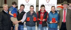 Kenny Linton, from Dunbia, with Stephen and Charlie Baxter, winners of the best spring-born heifer competition, William McMordie, winner of the best autumn-born bull and heifer calf competitions, Robbie Wilson, winner of the best spring-born bull calf competition, Ciaran Kerr, winner of the best stock bull competition, and James Nelson, judge. Picture: Cliff Donaldson