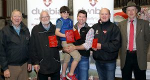Eddie Boyd, from Dunbia, with Bertie Watson, reserve in the small herd of the year competition, Stephen and Charlie Baxter, champion small herd of the year, William Haire, third place in the small herd of the year competition, and James Nelson, judge. Picture: Cliff Donaldson