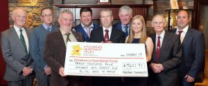 Committee members handing over a cheque to the Children's Heartbeat Trust at the Hereford Society annual dinner. Picture: Cliff Donaldson (See Ivan Haire for full caption)